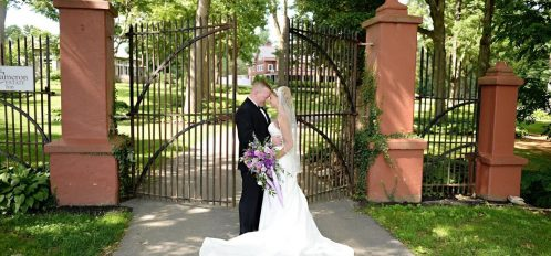 Bride and Groom in front of Cameron Estate Inn Gate