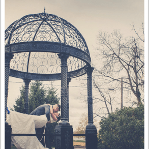 bride and groom under cupola
