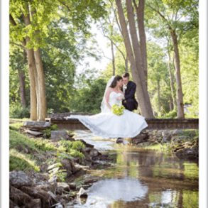 bride and groom at stream