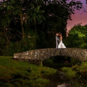couple on a stone bridge