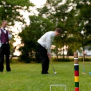 Groomsmen playing croquet